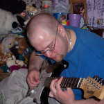 DJ digitalflood playing a First Act Strat Clone Guitar